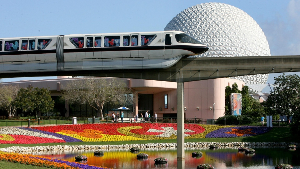 In this March 19, 2009 file photo, a Disney World monorail passes Spaceship Earth at Walt Disney World's Epcot Center in Lake Buena Vista, Fla. (AP Photo/Orlando Sentinel, Joe Burbank, file)