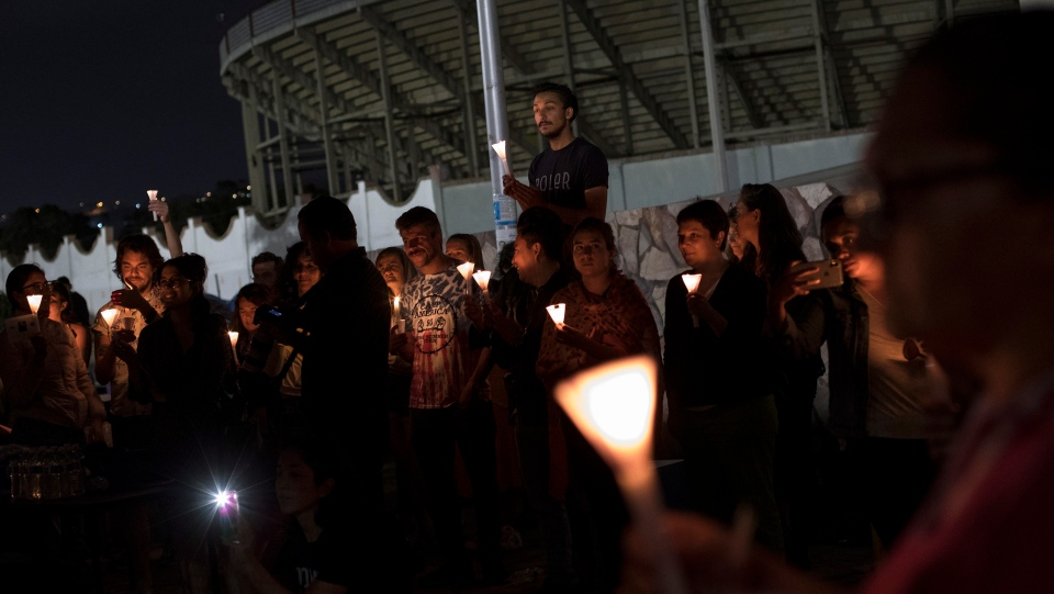 "People hold a candlelight vigil to protest against U.S. immigration policies and detention conditions, next to the U.S. border wall in Tijuana, Mexico, Friday, July 12, 2019. The gathering on the beach in Tijuana was one of numerous ""Lights for Liberty"" protests held across the U.S. and Mexico on Friday. (AP Photo/Hans-Maximo Musielik)"