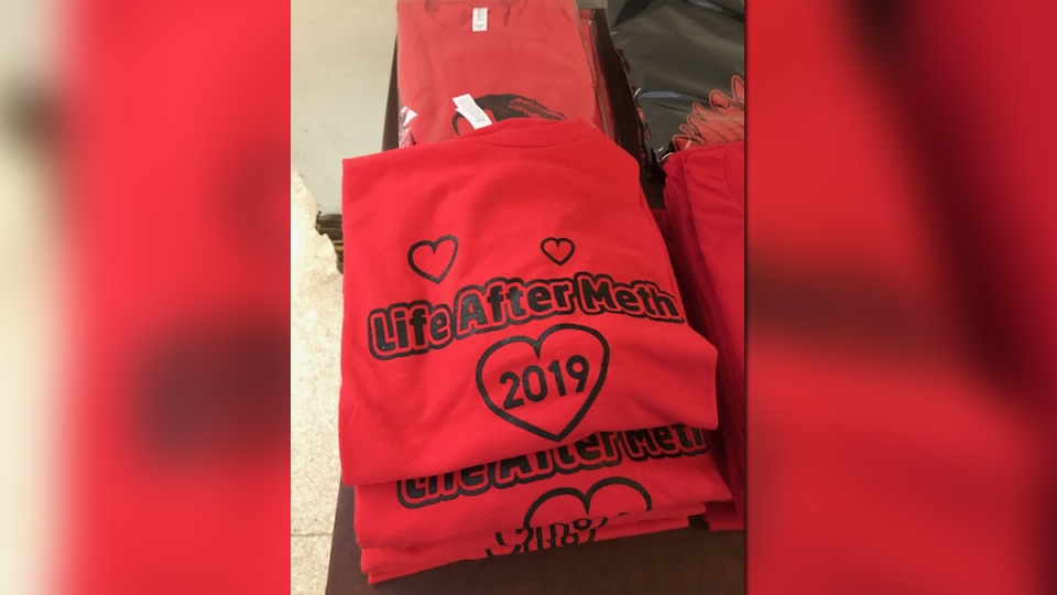 "The event supplied information for mental health services and ""Life After Meth"" t-shirts. (Photo: Jason Gaidola/ CTV News Winnipeg)"