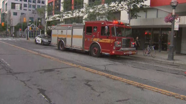 Emergency crews respond to reports of a man falling into the elevator shaft of a building near John and Front streets on July 13, 2019.