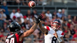 Ottawa Redblacks defensive back Anthony Cioffi (8) attempts to block a pass from Montreal Alouettes quarterback Vernon Adams Jr. during second half CFL action in Ottawa, Saturday, July 13, 2019. The Alouettes defeated the RedBlacks 36-19. THE CANADIAN PRESS/Adrian Wyld