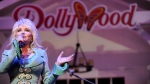 In this Aug. 21, 2013 file photo, Dolly Parton speaks during a news conference in Pigeon Forge, Tenn. (Amy Smotherman Burgess/Knoxville News Sentinel via AP)