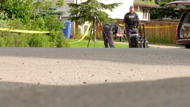 Police tape could be seen stretched for several blocks as officers photographed the scene.