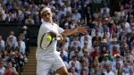 Switzerland's Roger Federer returns the ball to Serbia's Novak Djokovic during the men's singles final match of the Wimbledon Tennis Championships in London, Sunday, July 14, 2019. (Adrian Dennis/Pool Photo via AP)