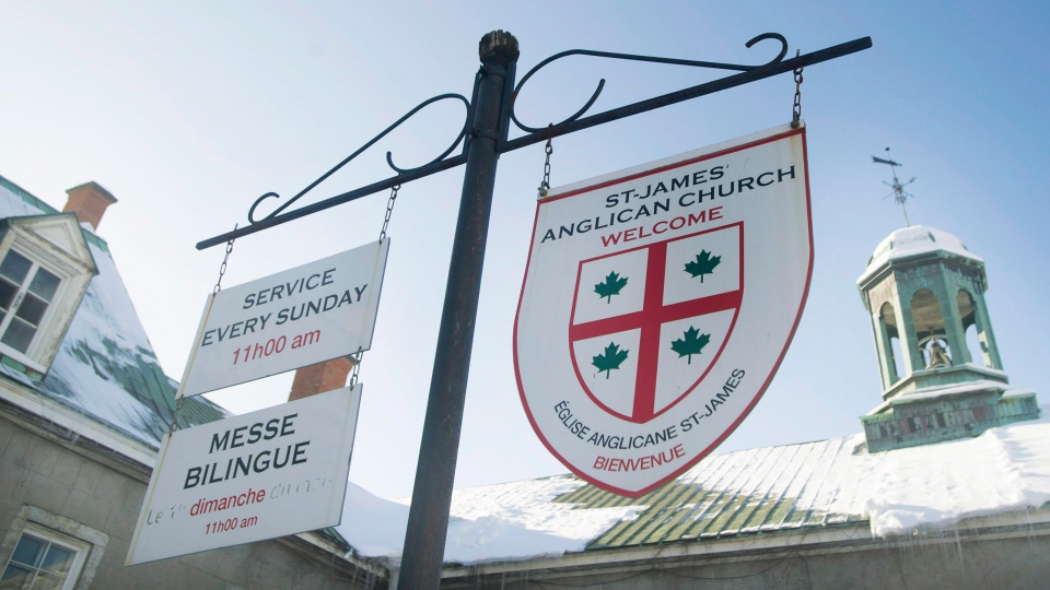 Signs in English and French hang outside St. James Anglican Church in Trois-Rivières, Que., Sunday, January 25, 2015. (THE CANADIAN PRESS / Graham Hughes)