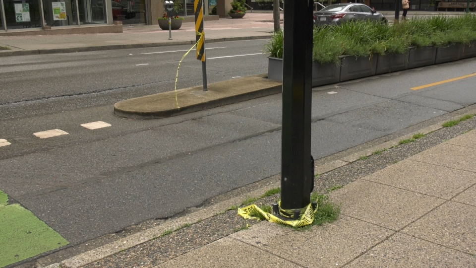Police tape could be seen at the scene of a stabbing on Hornby Street near Dunsmuir Street Saturday morning. (CTV)
