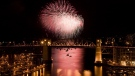 The Burrard Street Bridge is seen in the foreground as fireworks from team China blast over the waters of English Bay during the 21st annual Celebration of Light in Vancouver, Saturday, July 30, 2011. (THE CANADIAN PRESS / Jonathan Hayward)