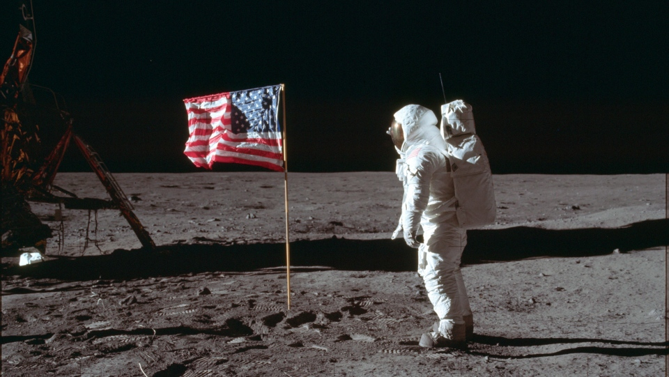 NASA astronaut Buzz Aldrin Jr. poses for a photograph beside the U.S. flag on the moon during the Apollo 11 mission. (July 20, 1969/Neil Armstrong/NASA via AP)