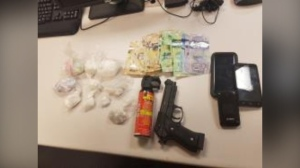 Police seized a number of drugs, some cash and a fake gun after stopping a car in Kitchener. (@WRPSToday / Twitter)