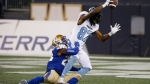 Toronto Argonauts' Derel Walker (87) celebrates his touchdown as he dives across the line while Winnipeg Blue Bombers' Chandler Fenner (22) hangs on during second half CFL football action in Winnipeg, Friday, July 12, 2019. THE CANADIAN PRESS/John Woods