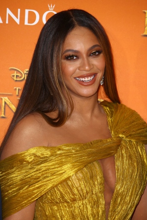 Singer Beyonce poses for photographers upon arrival at the 'Lion King' European premiere in central London, Sunday, July 14, 2019. (Photo by Joel C Ryan/Invision/AP)