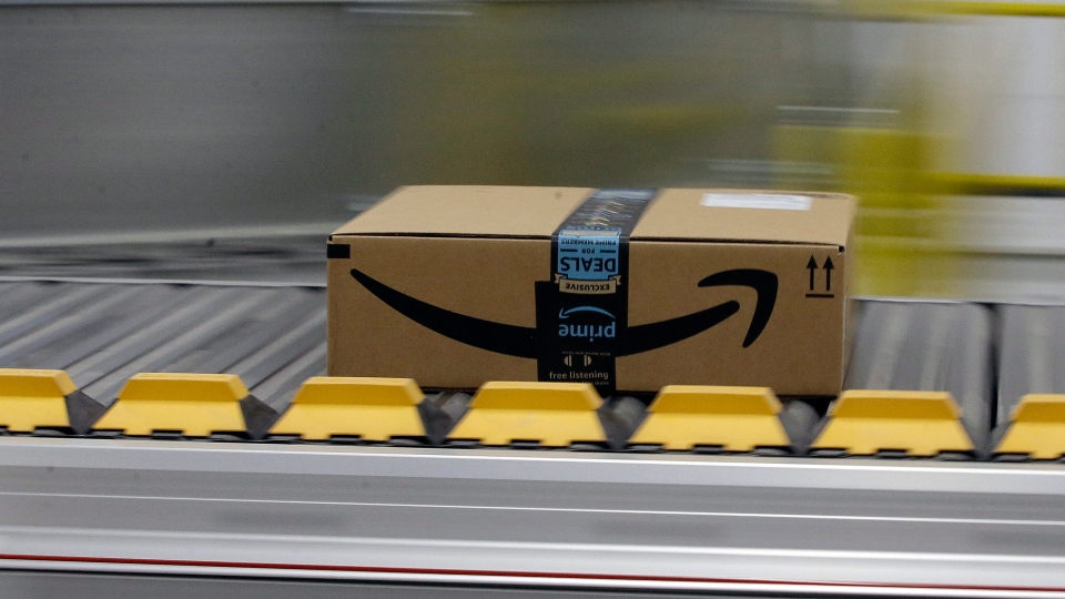 FILE - In this Feb. 9, 2018, file photo a box for an Amazon prime customer moves through the new Amazon Fulfillment Center in Sacramento, Calif.  (AP Photo/Rich Pedroncelli, File)
