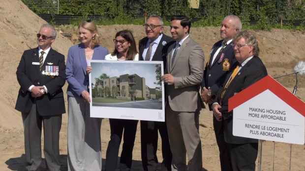 Federal Minister of Seniors Filomena Tassi, third from left, and other officials unveil plans for a new housing complex for seniors and veterans in London, Ont. on Monday, July 15, 2019. (Marek Sutherland / CTV London)