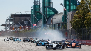 Simon Pagenaud of France leads the pack on his way to taking first place at the 2019 Honda IndyToronto, in Toronto, Sunday, July 14, 2019. THE CANADIAN PRESS/Mark Blinch