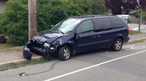Police say this blue Dodge Caravan van struck a grey Yamaha scooter and a grey Honda Civic in the 1800-block of McKenzie Avenue. (CTV Vancouver Island)
