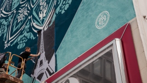 Shepard Fairey is seen working on a mural in this image from the Burrard Arts Foundation's website.