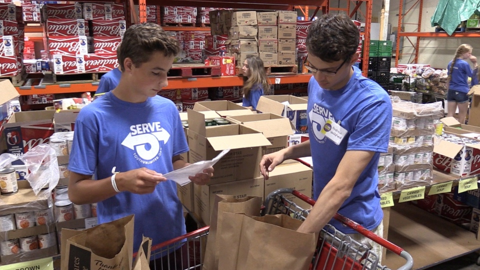 Participants in the 'Serve' youth mission volunteer at the London Food Bank in London, Ont. on Monday, July 15, 2019. (Celine Moreau / CTV London)