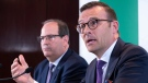 Desjardins President and CEO Guy Cormier responds to a question as Senior Executive Vice-President and Chief Operating Officer Denis Berthiaume looks on during a news conference in Montreal on Thursday, June 20, 2019. THE CANADIAN PRESS/Paul Chiasson