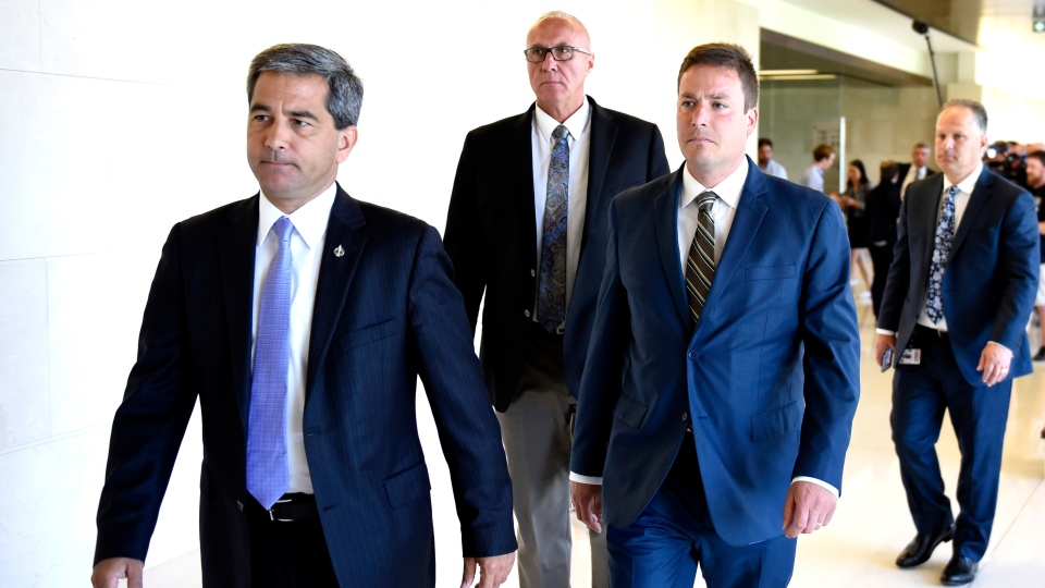 Conservative MPs Pierre Paul-Hus, left, Glen Motz and Alupa Clarke arrive for a meeting of the Standing Committee on Public Safety and National Security to discuss their request for a study of the Desjardins Group Data Breach, in Ottawa on Monday, July 15, 2019. THE CANADIAN PRESS/Justin Tang