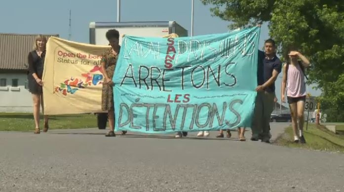 Demonstrators protest the planned migrant detention centre in Laval.