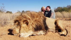 This image of Darren and Carolyn Carter has drawn the ire of animal rights advocates (Courtesy: Daily Mirror)