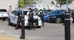 Police investigate after a baby was found inside a hot car in Oshawa yesterday.