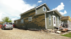 The siding on Rita Tessier's home destroyed after Sunday's storm. (Laura Woodward/CTV Saskatoon)