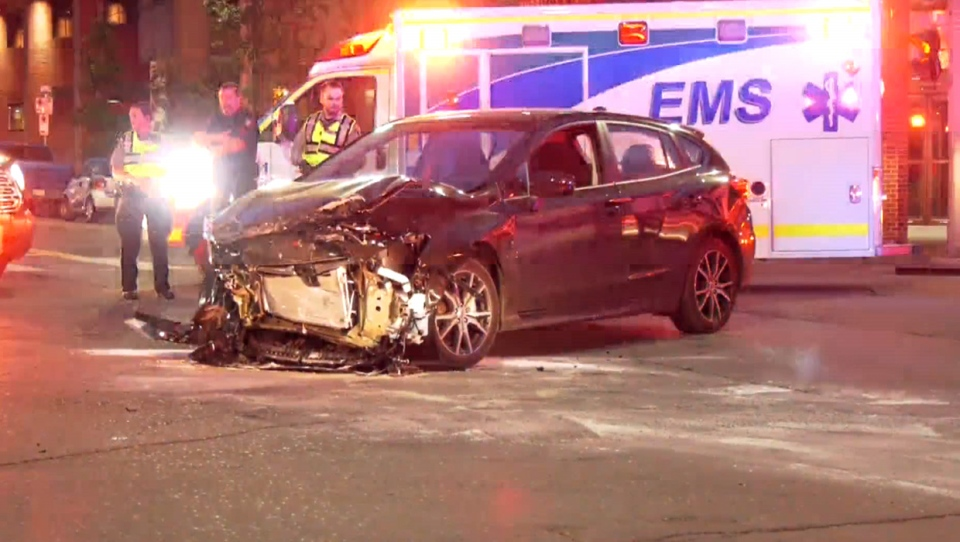 A car with significant front-end damage following Monday night's crash in the downtown core