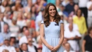 Kate, Duchess of Cambridge stands on centre court during the trophy presentation after Serbia's Novak Djokovic defeated Switzerland's Roger Federer during the men's singles final match of the Wimbledon Tennis Championships in London, Sunday, July 14, 2019. (Laurence Griffiths/Pool Photo via AP)
