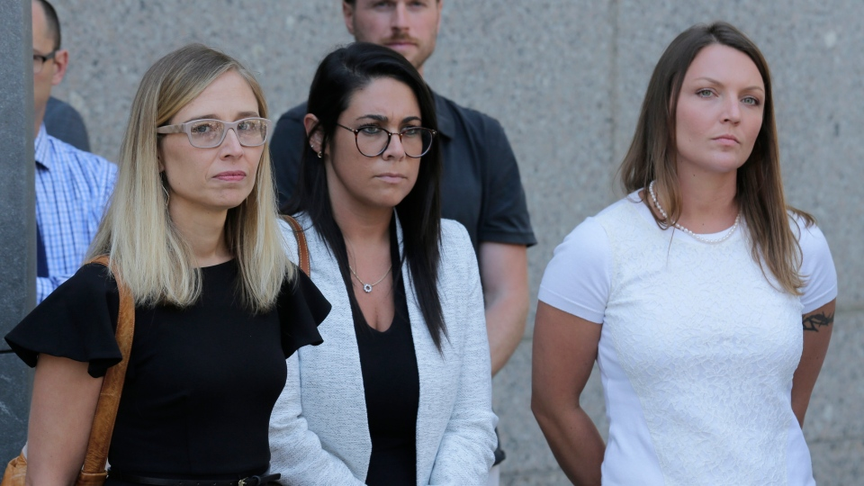 Annie Farmer, left, and Courtney Wild, right, accusers of Jeffrey Epstein, stand outside the courthouse in New York. (Seth Wenig/Associated Press)
