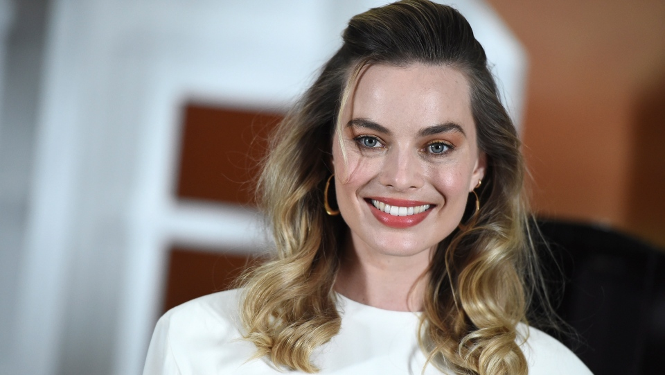 Margot Robbie attends the photo call for