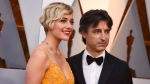 Greta Gerwig, left, and Noah Baumbach arrive at the Oscars on Sunday, March 4, 2018, at the Dolby Theatre in Los Angeles. (Photo by Jordan Strauss/Invision/AP)