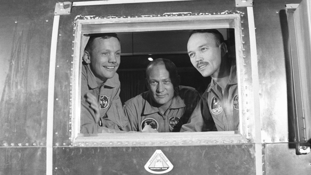 In this July 27, 1969 file photo, Apollo 11 crew members, from left, Neil Armstrong, Buzz Aldrin and Michael Collins sit inside a quarantine van in Houston. (AP)