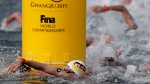 Florian Wellbrock of Germany competes in the men's 10km open water swim at the World Swimming Championships in Yeosu, South Korea, Tuesday, July 16, 2019. (AP Photo/Mark Schiefelbein)