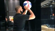 Drake is seen shooting a basket at the court inside his Toronto mansion in this screengrab. (Instagram / @champagnepapi)