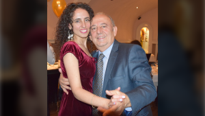 Iris Kulbatski poses for a photo with her father Henry Kulbatski at her parents' 50th wedding anniversary in 2016. (Supplied by Iris Kulbatski)
