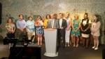 City councillors and advocates speak about child care funding on July 16, 2019.