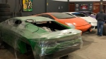This July 15, 2019 photo released by Itajai Civil Police, shows car molds of luxury car replicas at a workshop in Itajai, Brazil. (Itajai Civil Police via AP)