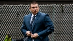 In this May 13, 2019, file photo, New York City police officer Daniel Pantaleo leaves his house in Staten Island, N.Y. (AP Photo/Eduardo Munoz Alvarez, File)