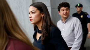 Rep. Alexandria Ocasio-Cortez, D-N.Y., walks out of a House of Representatives office building, Tuesday, July 16, 2019, on Capitol Hill in Washington. (AP Photo/Patrick Semansky)