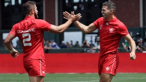 FILE - Canada's Justin Douglas, right, is congratulated by Admir Cejvanovic, left, after scoring against Japan during the Rugby Sevens World Cup in San Francisco, Saturday, July 21, 2018. THE CANADIAN PRESS/AP-Jeff Chiu