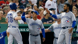 Toronto Blue Jays' Billy McKinney (28) celebrates after scoring on a double by Eric Sogard during the ninth inning of the team's baseball game against the Boston Red Sox in Boston, Tuesday, July 16, 2019. (AP Photo/Michael Dwyer)