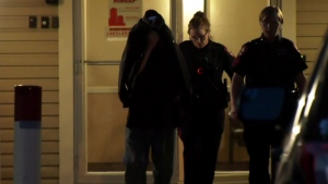 An unidentified person was escorted from the apartment building during the investigation into suspected animal abuse