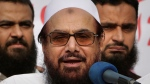 In this Friday, Oct. 26, 2018 file photo, Hafiz Saeed, founder of Pakistani religious group Jamaat-ud-Dawa addresses an anti-Indian rally in Lahore, Pakistan. (AP Photo/K.M. Chaudary, File)