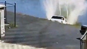 Driver accidentally sends SUV into river