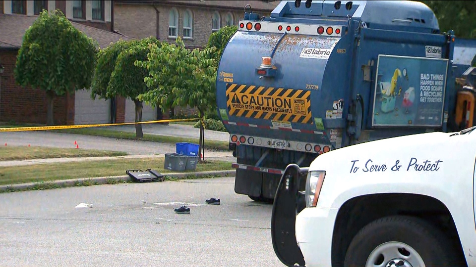 The shoes of a woman killed by a garbage truck in North York lay on the road as police investigate. (CTV Toronto)