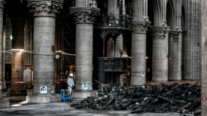 Workers are pictured during preliminary work at the Notre-Dame de Paris Cathedral, Wednesday, July 17, 2019 in Paris. (Stephane de Sakutin/Pool via AP)