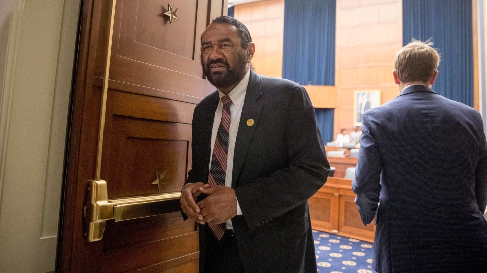 Rep. Al Green, D-Texas, right, walks during a break from testimony from David Marcus, CEO of Facebook's Calibra digital wallet service, before a House Financial Services Committee hearing on Facebook's proposed cryptocurrency on Capitol Hill in Washington, Wednesday, July 17, 2019. (AP Photo/Andrew Harnik)