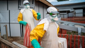 Health workers wearing protective suits take their shift at a treatment center in Beni, Congo DRC, Saturday, July 13, 2019. (AP / Jerome Delay)