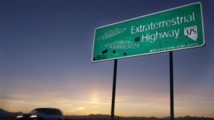 In this April 10, 2002, file photo, a car moves along the Extraterrestrial Highway near Rachel, Nev, the closest town to Area 51. (AP Photo/Laura Rauch, File)